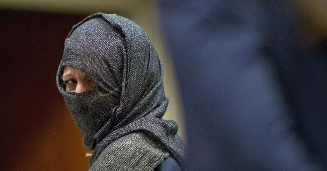 Woman charged after threats at mosque reaches plea deal
