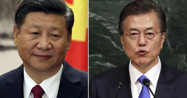 SKorea, China move to resolve disputes and hold summit talks