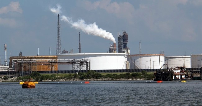 Exxon settles pollution case with US, will upgrade 8 plants