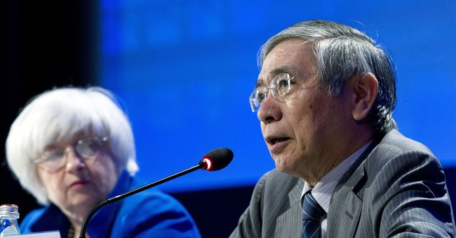 Japan central bank keeps policy intact, cuts price outlook