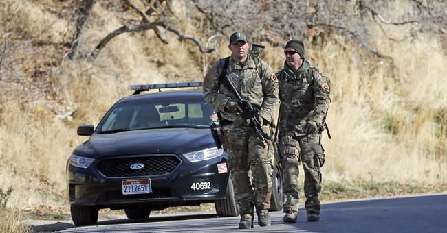 The Latest: Police: Gunman tried to drag woman up canyon
