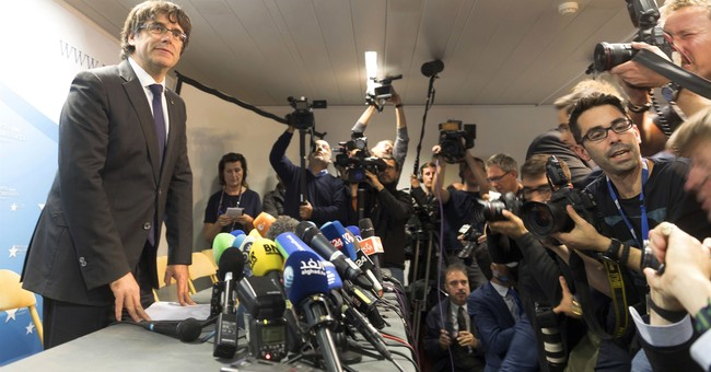 The Latest: Lawyer: Puigdemont should be quizzed in Belgium