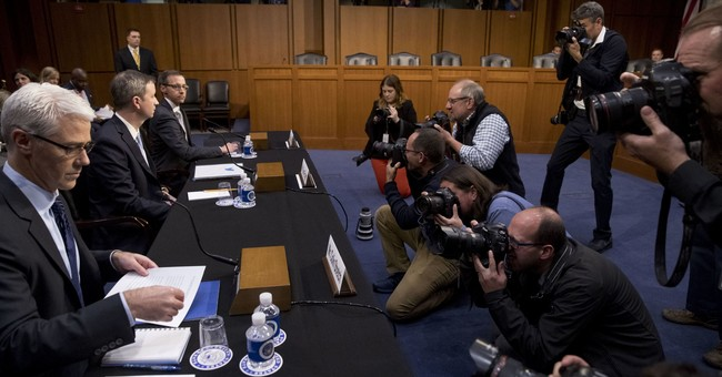 The Latest: Senators slam tech companies over Russia links
