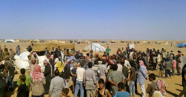 Access to food 'precarious' for Syrians stranded near Jordan