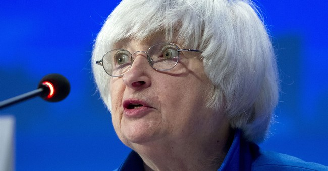 Fed leaves key rate unchanged but hints at future hikes