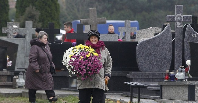 Poles mark day of the dead with visits to family graves