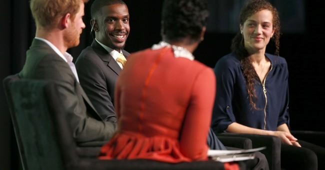 Prince Harry visits Chicago school, talks at Obama summit