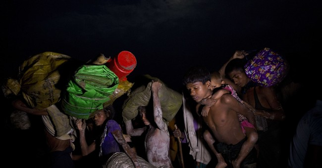Terrified Rohingya Muslims await chance to enter Bangladesh