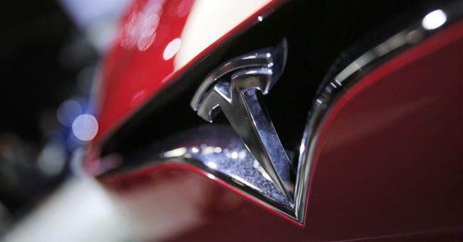 Tesla posts record quarterly loss of $619M on Model 3 delays