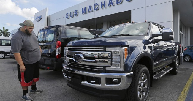 US auto sales fall even with strong sales of SUVs and trucks