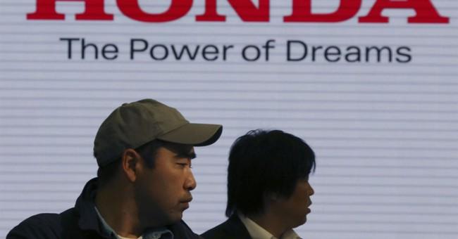 Honda profit slips on air-bag woes despite sales growth