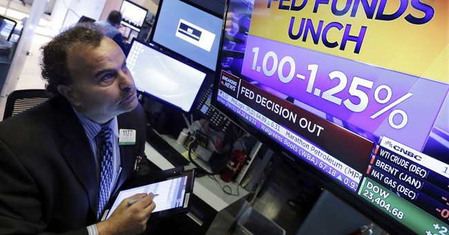 Asian markets mostly lower as market waits next Fed leader