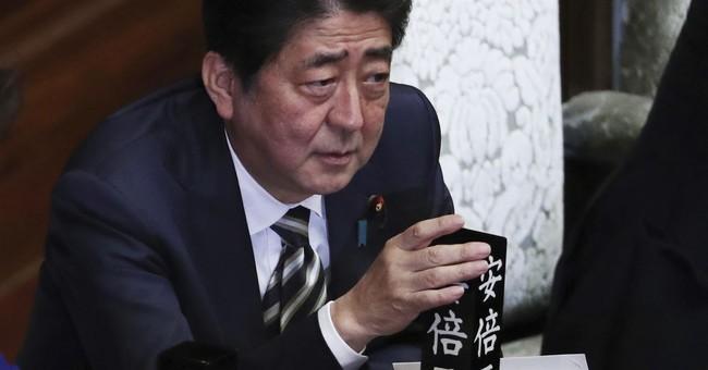 The Latest: Japan PM pledges $17.5B package