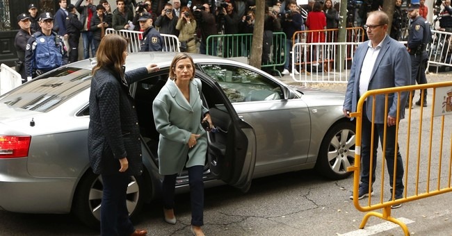 Spain judge jails Catalan ministers, mulls leader's arrest