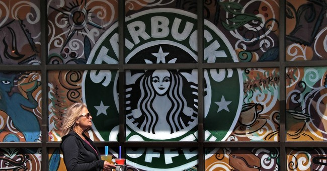 Starbucks to launch credit card, sell Tazo; sales disappoint