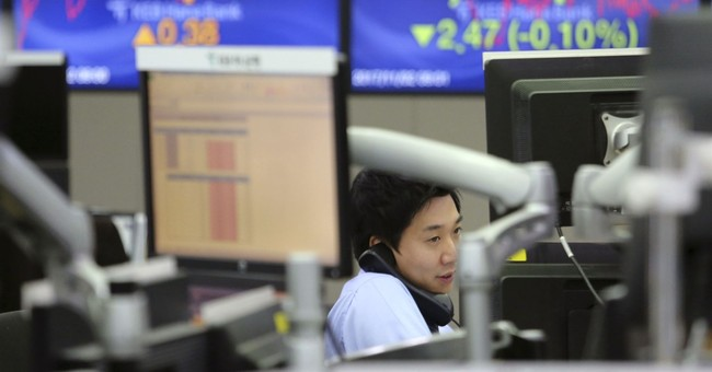 Asia shares muted as investors assess Fed pick, US tax plan
