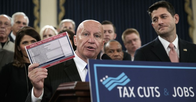 The Latest: Tax bill revisions means less-generous cuts