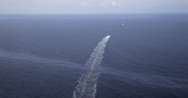 Settlement talks continue in suit over 13-year-old oil leak