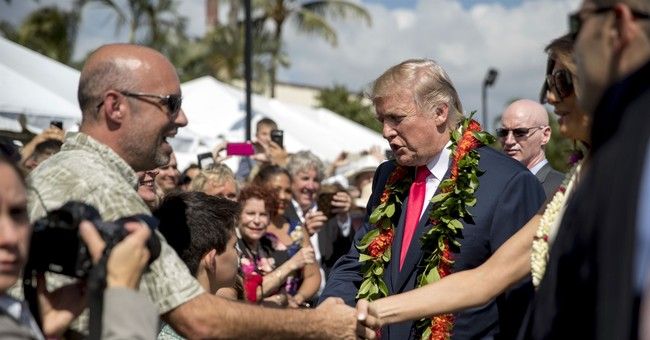 The Latest: President makes stop at Trump hotel in Honolulu