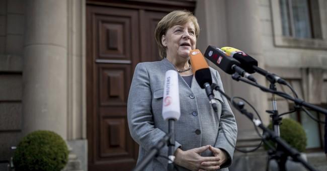 Merkel still optimistic on forming new German coalition