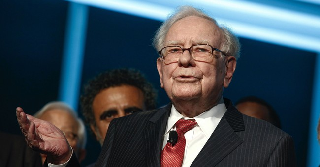 Insurance loss from disasters cuts profits at Buffett's firm