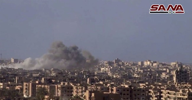 Assaults in Syria and Iraq oust IS from border bastions