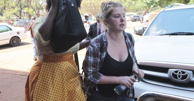 The Latest: American accused in Zimbabwe to stay in jail