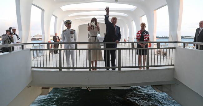 On eve of Asia trip, Trump pays visit to Pearl Harbor
