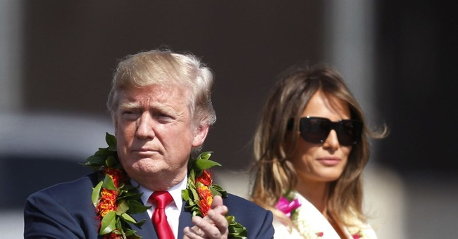 A look at who's off to Asia with Trump, who's staying behind