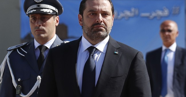 AP Explains: What is behind the Lebanese PM's resignation
