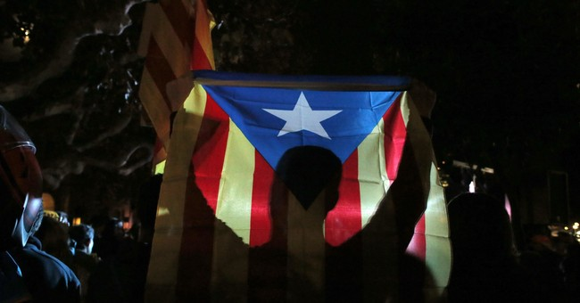 The Latest: Catalan 5 cannot leave Belgium before ruling