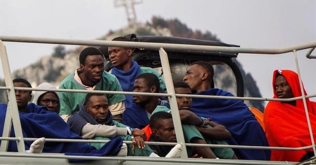 Bodies of 26 migrants arrive in Italy as rescues intensify