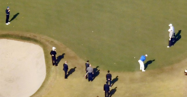 Trump unaware as Abe falls in bunker during golf game