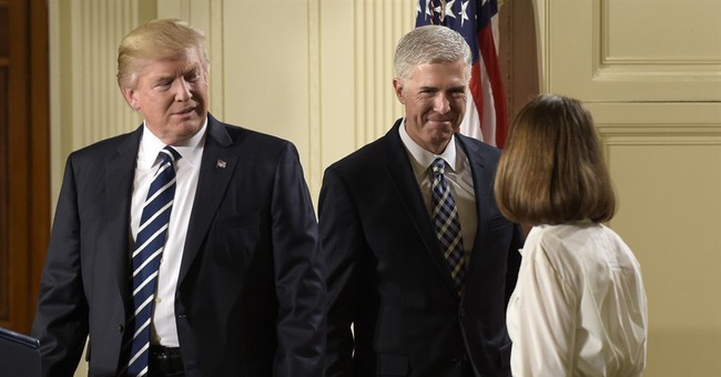 The Latest: White house plans major outreach by Gorsuch