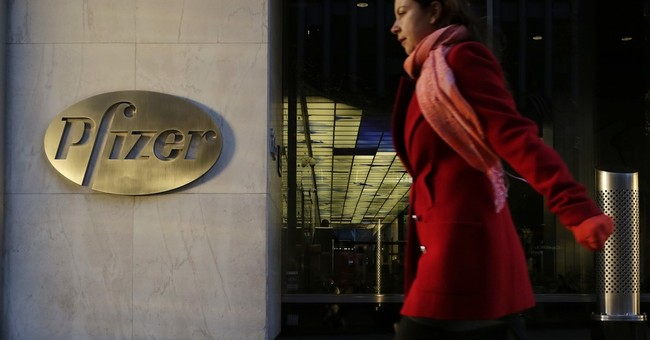 Pfizer swings to 4Q profit after rough year, hikes 2017 view