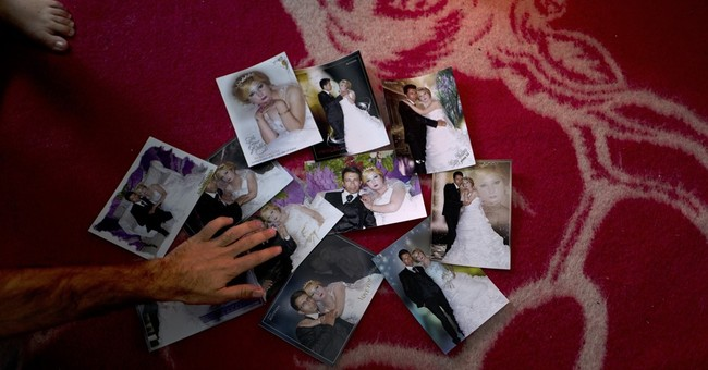 AP Photos: Syrians stuck in Greece share memories from home