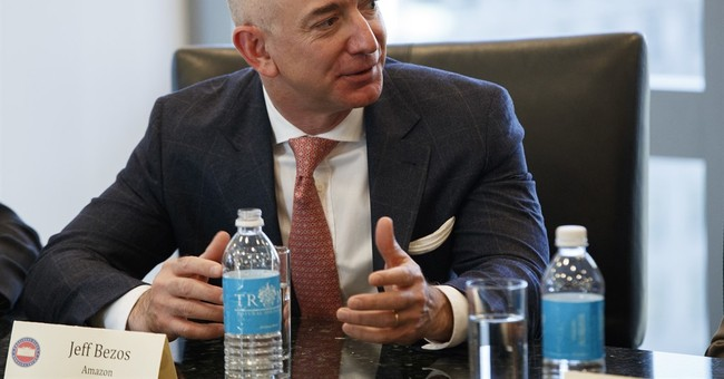 CEO Jeff Bezos says Amazon backs suit opposing Trump order