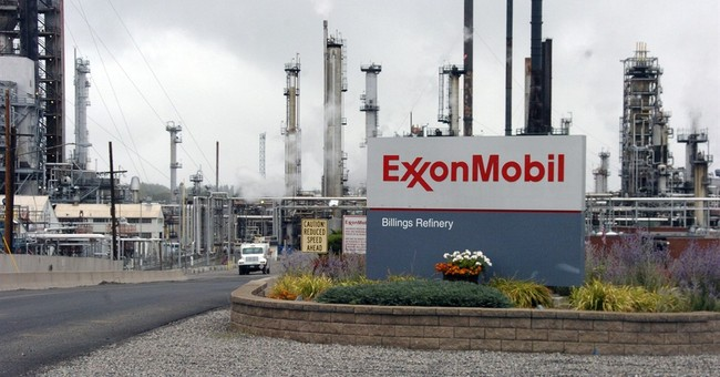Exxon reports big drop in 4Q profit, takes gas write-down