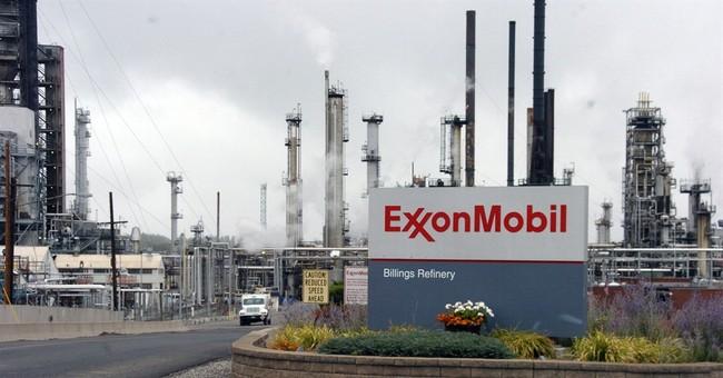 Exxon reports big drop in 4Q profit, takes gas write-down