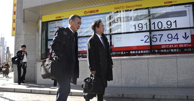 Japan central bank upgrades outlook, keeps policy intact