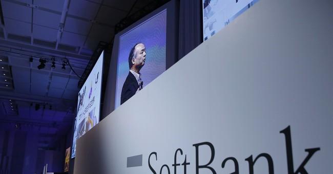 SoftBank raising stake in Sprint, reports falling profit