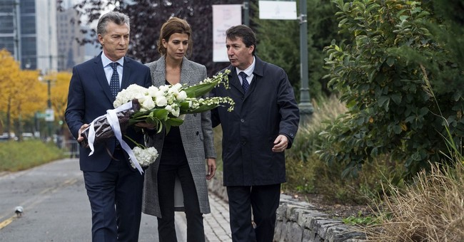 Argentina president places memorial flowers at NYC bike path