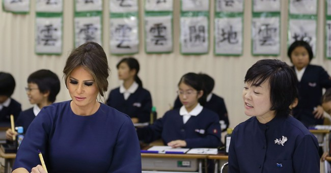 US first lady learns calligraphy at Japanese primary school