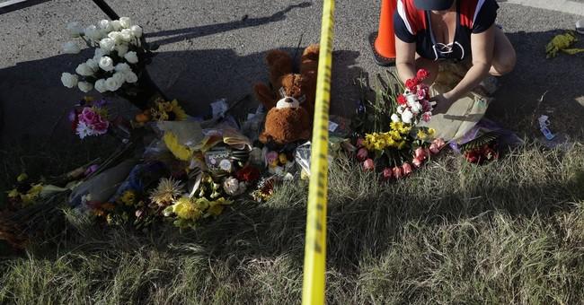 The Latest: 2 men who pursued gunman attend shooting vigil