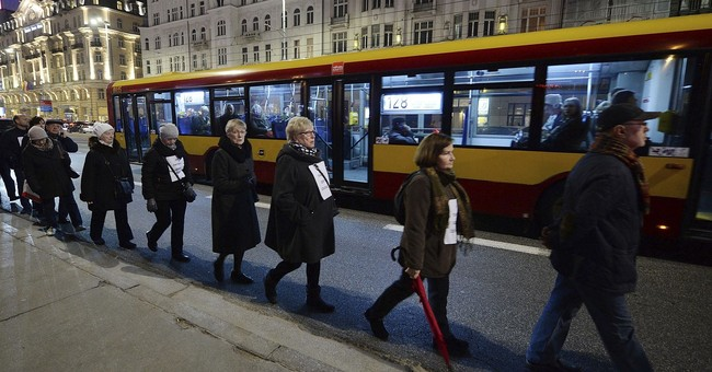 Silent march in Poland honors man who set himself on fire