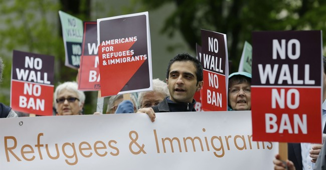 Seattle lawsuit challenges bar on entry of refugee's family