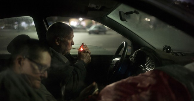 AP PHOTOS: Homeless crisis pushes poverty into the open