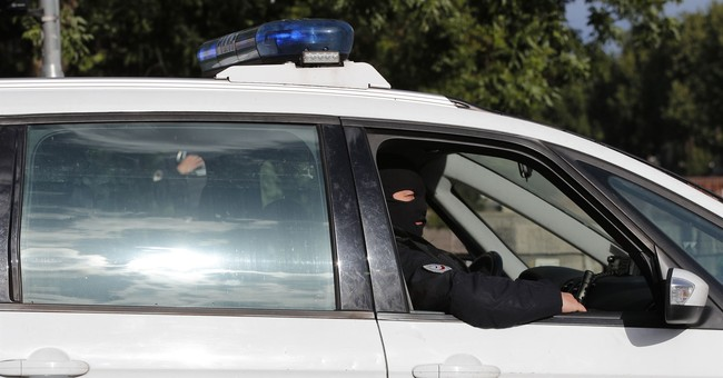 10 arrests in French, Swiss raids over suspected attack plot