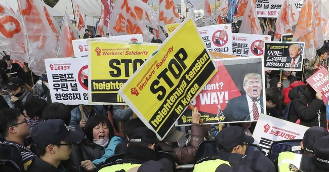 S. Koreans demonstrate to show support, disapproval of Trump