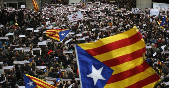 Judge jails, sets bail for top lawmaker in Catalonia probe
